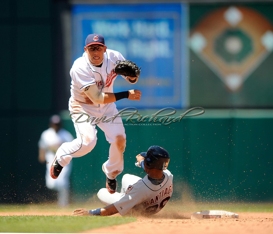 Cleveland infielder Asdrubal Cabrera of the Cleveland Indians turns a double play as Detroit's Ramon Santiago slides into second base..The Cleveland Indians defeated the Detroit Tigers 9-4 on Thursday, July 31, 2008 at Progressive Field in Cleveland.