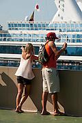 Tourists couple at the Miraflores Locks visitors center. Panama Canal, Panama City, Panama, Central America.