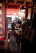 Caretaker napping at the Temple of Literature