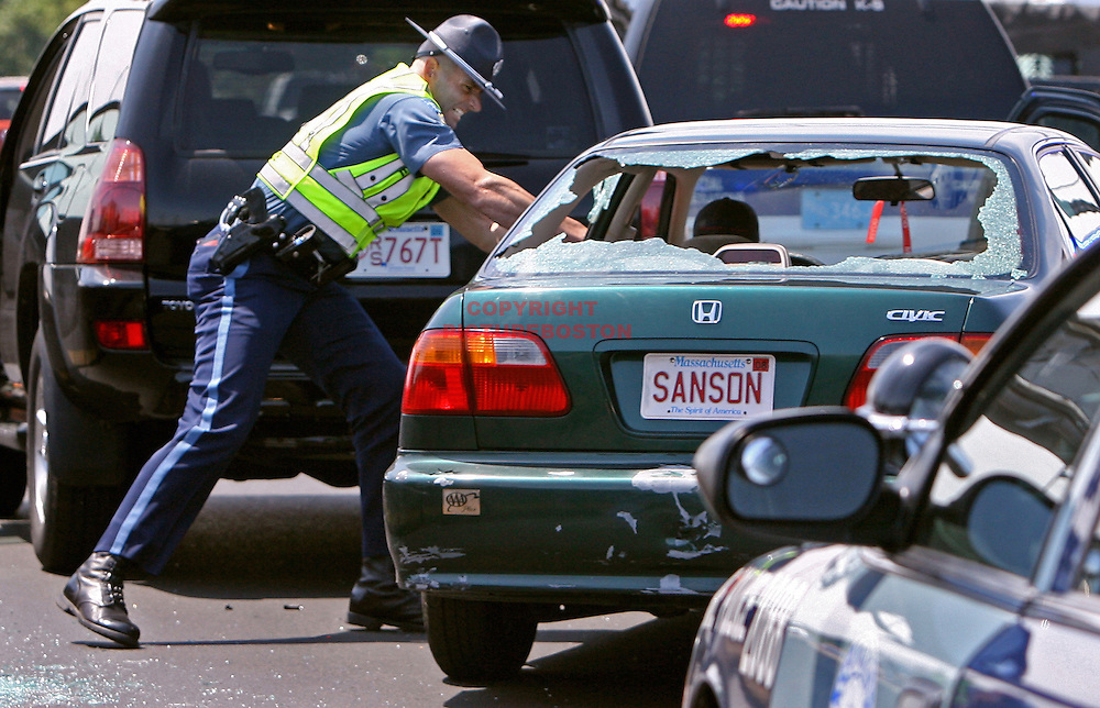 (07/22/08-Boston,MA)  A police officer reaches through a shattered window to try and grab the keys and stop the aftermath of a high speed car pursuit, with one victim screaming for help and the driver refusing to stop.
