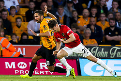 Daniel James of Manchester United goes down under a challenge from Joao Moutinho of Wolverhampton Wanderers but is booked for diving - Mandatory by-line: Robbie Stephenson/JMP - 19/08/2019 - FOOTBALL - Molineux - Wolverhampton, England - Wolverhampton Wanderers v Manchester United - Premier League