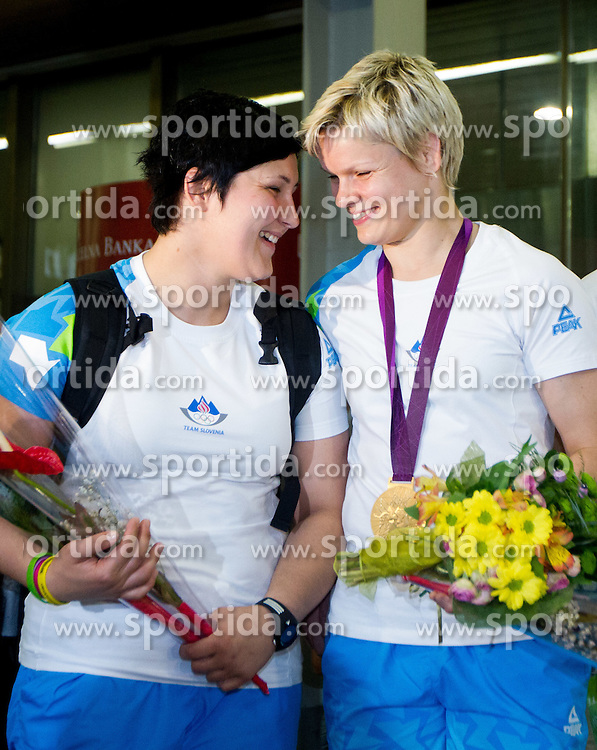 Lucija Polavder and Gold judo medalist Urska Zolnir during reception of Slovenian Olympic team, on August 5, 2012 in Airport Joze Pucnik, Brnik, Slovenia. (Photo by Vid Ponikvar / Sportida.com)
