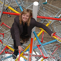 Brit-pop artist Abigail Fallis and her shopping trolley sculpture at Imperial College, London, on Thursday 4th December 2003 where pioneering research into Muscular Dystrophy is carried out. The 14 foot high sculpture is in the shape a DNA helix.<br /> &copy; Photo by Terry Kane