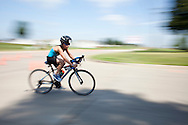Landon Hoppe of Clive cruises around a corner and into the finish of the bike portion of her 6-8 year old division heat at the Rip Roar Kids Triathlon in Cherry Hill Park in Cedar Rapids on Saturday, July 25, 2015. Rip Roar is in its first year of event production under the leadership of Michael Zimmerman, who previously led the HyVee IronKids and Kids Fit Series. The organization's goal is to rejuvenate communities by bringing high energy athletic events to the Midwest. (Rebecca F. Miller/Freelance for the Gazette)