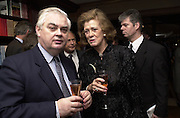 Norman Lamont and the Duchess of St. Albans. Gunmaker's Boss and Co's launch party new Mayfair premises. Mount St. London. 12 December 2000. © Copyright Photograph by Dafydd Jones 66 Stockwell Park Rd. London SW9 0DA Tel 020 7733 0108 www.dafjones.com
