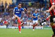 Kyle Bennett gets a shot on target during the Sky Bet League 2 match between Portsmouth and Morecambe at Fratton Park, Portsmouth, England on 22 August 2015. Photo by David Charbit.