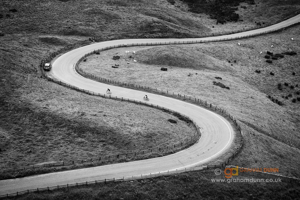 Two cyclists enjoy the winding decent through Mam Nick to Edale in the Peak District. Commended, Landscape Photographer of the Year 2016.