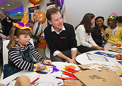 © London News Pictures. 31/10/2013 . London, UK. NICK CLEGG talking to GOSH patient ELIZABETH BURROWS (left, aged 4). Deputy Prime Minister nick Clegg and his wife Miriam Gonzalez Durantz meet children, parents and volunteers at the Great Ormond Street Hospital annual Halloween party.  Photo credit : Ben Cawthra/LNP