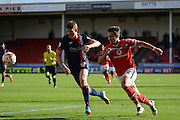 Goalscorer Tom Bradshaw attacks watched by Gary MacKenzie during the Sky Bet League 1 match between Walsall and Doncaster Rovers at the Banks's Stadium, Walsall, England on 12 September 2015. Photo by Alan Franklin.