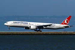 Boeing 777-3F2(ER) (TC-JJI) operated by Turkish Airlines landing at San Francisco International Airport (KSFO), San Francisco, California, United States of America