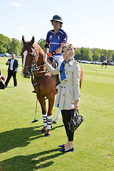 Polo player  NACHO FIGUERAS and DELFINA FIGUERAS at the St.Regis International Polo Cup at Cowdray Park, Midhurst, West Sussex on 16th May 2015.