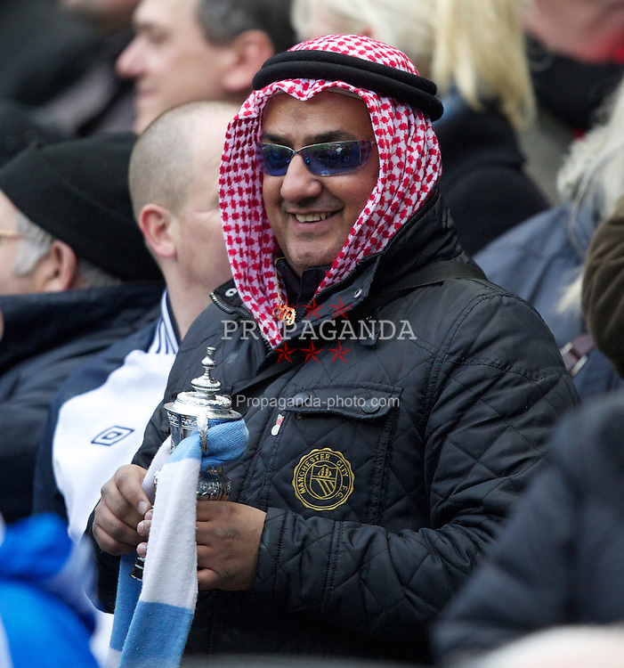 MANCHESTER, ENGLAND - Sunday, January 8, 2012: Manchester City supporter dressed as an Arab against Manchester United during the FA Cup 3rd Round match at the City of Manchester Stadium. (Pic by Vegard Grott/Propaganda)