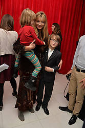 NATASCHA McELHONE and her children OTIS KELLY and REX KELLY (in red) at a pre party for the English National Ballet's Christmas performance of The Nutcracker was held at the St.Martin's Lane Hotel, St.Martin's Lane, London on 12th December 2013.