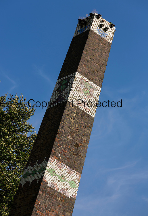 The Clayton Fireclay Works mill chimney, off Brow Lane, Clayton West Yorkshire. The works were established in 1880. The chimney was buit when the works were enlarged in 1907. When Bradford City won the F.A. cup in 1911, the owner Claude Whitehead celebrated by decorating the chimney with a stylized image of the F.A. cup, in glazed tiles from his own works.