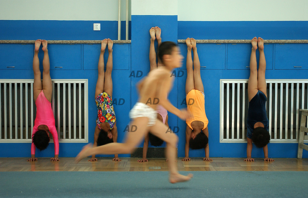 Training in Shichahai Sport School. Founded by Beijing municipality in 1958. The younger students are 5 years old, the older 19. The school offer 9 disciplines. In the last Olympic Games 5 students won gold medals: ping pong, TaekWondo, volleyball, pommel horse, gymnastic.