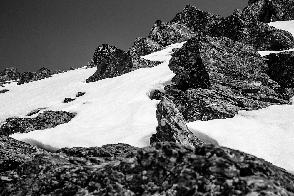 The rocky snow encrusted spring landscape of Glacier National Park.