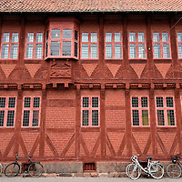 Møntergården Museum in Odense, Denmark<br /> If you want a flavor of what Denmark looked like during the Middle Ages, then head towards the Møntergården Museum. This is its namesake building on a street named Overgade. The red brick, half-timbered farm structure with ornate rosettes was built in 1646 by nobleman Falk Gøye. The structure was restored in 1930 and became a museum in 1941. Inside are numerous exhibits tracing Odense's history back to its founding in 988. Also on display is the Koelbjerg Man. These skeletal remains are from ancient Denmark circa 8000 BC.