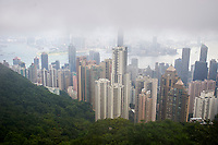 View to the harbour and commercial district from Victoria Peak with low lying cloud and pollution haze Hong Kong