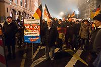 """05 JAN 2015, BERLIN/GERMANY:<br /> Demonstrant mit einem Schild der AfD, Alternative für Deutschland """"Mut zu Deutschland"""", Bärgida-Demo """"Berliner Patrioten gegen die Islamisierung des Abendlandes"""", Spandauer Strasse<br /> IMAGE: 20150105-01-040<br /> KEYWORDS: Bärgida, Demonstranten, Protest, Demonstration, Flaggen"""
