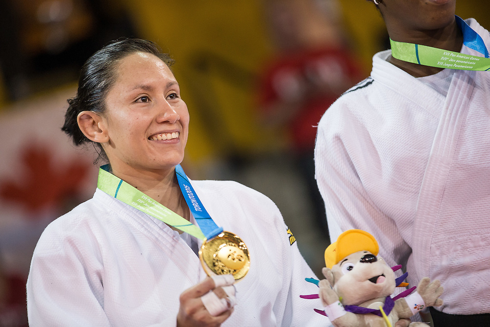 Gold medalist Estefania Garcia of Ecuador poses for a photo with her medal following the medal ceremony for the women's judo -63kg class at the 2015 Pan American Games in Toronto, Canada, July 13,  2015.  AFP PHOTO/GEOFF ROBINS