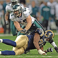 Philadelphia linebacker Mark Sinoneau (53) takes on a block from St. Louis Rams Alex Barron (70) during the fourth quarter, at the Edward Jones Dome in St. Louis, Missouri, December 18, 2005.  The Eagles beat the Rams 17-16.