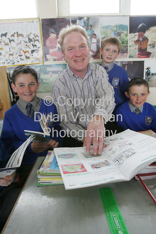 21/5/2004.Joe Conway pictured at Killea National School in Dunmore East county Waterford with students from left Adam O Donoghue aged 10, Daniel O Sullivan aged 8 and Brian Flynn aged 10..Picture Dylan Vaughan