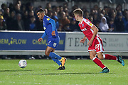 Gillingham defender Jack Tucker (27) chases down AFC Wimbledon striker Kweshi Appiah (9) during the EFL Sky Bet League 1 match between AFC Wimbledon and Gillingham at the Cherry Red Records Stadium, Kingston, England on 23 November 2019.