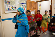 Garment workers arriving at a cafe meeting organised and hosted by Awaj Foundation, Dhaka, Bangladesh.<br /> <br /> Awaj Foundation was founded by Nazma Akter in 2003 to support and empower garment workers to negotiate safer and fairer working conditions in factories.