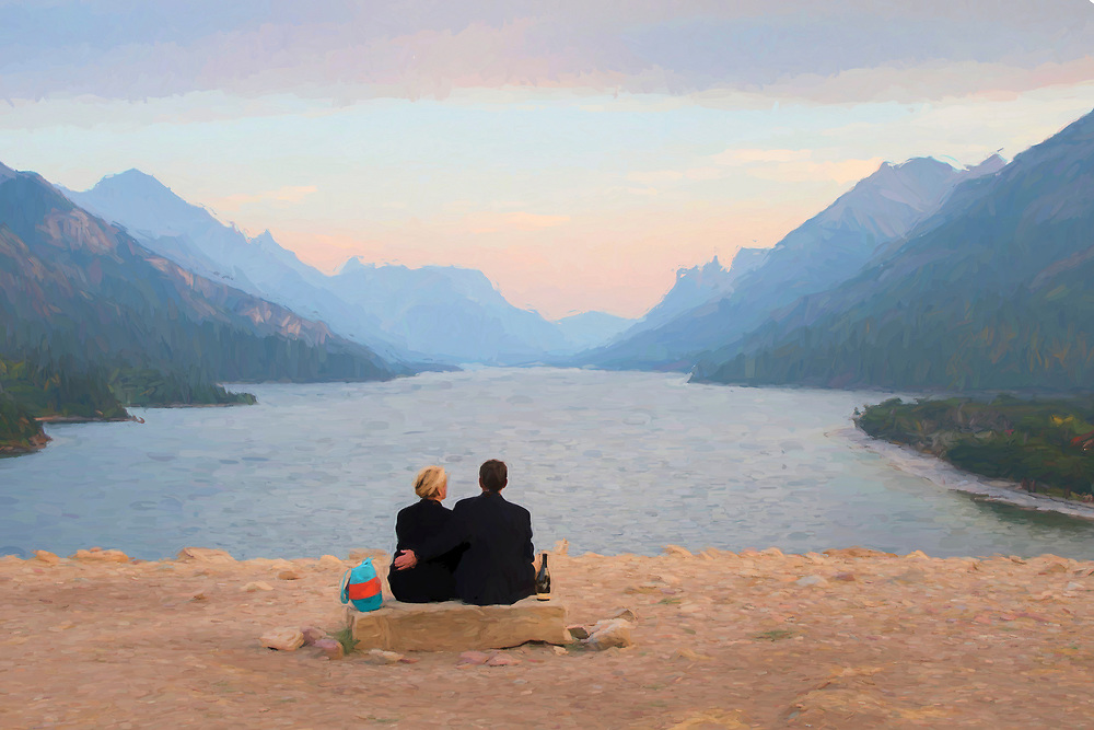 North America, Canada, Canadian,Alberta, Rocky Mountains, Waterton Lakes National Park, couple sitting on bench overlooking Waterton lake