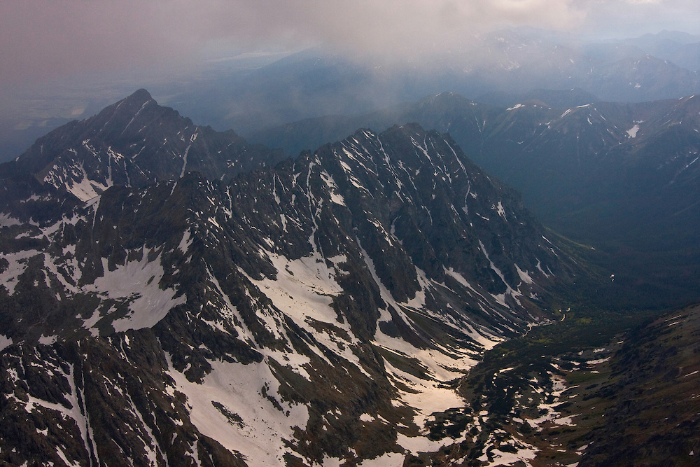 Aerial view of the massif of Mount Krivàn (2495m als), national symbol of Slovakia, with mount hruba kopa in the foreground and the Western Tatras on the background. High Tatras, Slovakia. June 2009. Mission: Ticha