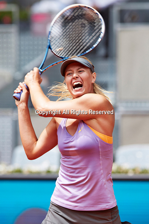 06.05.2014 Madrid, Spain. Maria Sharapova of Russia plays a double handed backhand during the game with  Christina Mchale of USA on day 3 of the Madrid Open from La Caja Magica.