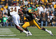 September 22 2012: Iowa Hawkeyes linebacker Christian Kirksey (20) eyes Central Michigan Chippewas running back Zurlon Tipton (34) during the first half of the NCAA football game between the Central Michigan Chippewas and the Iowa Hawkeyes at Kinnick Stadium in Iowa City, Iowa on Saturday September 22, 2012. Central Michigan defeated Iowa 32-31.