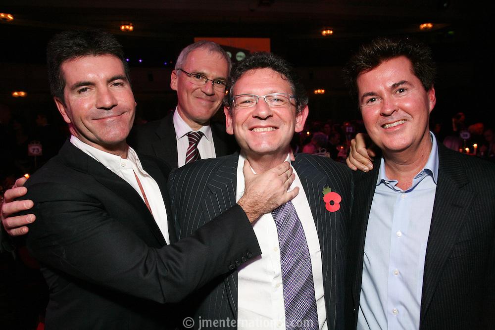 Left to Right Simon Cowell, Vivendi CEO Jean-Bernard Lévy, Lucian Grainge (MIT Awards recipient and Universal Music Group International Chairman/CEO) Simon Fuller (chief executive, 19 Entertainment)