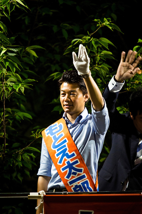 CHIBA, JAPAN - JULY 8 :  Taichiro Motoe a candidate from Liberal Democratic Party (LDP) waves to supporters in Chiba before his campaign speech in Shin-Urayasu Station during Upper house election campaign in Japan on July 8, 2016. The July 10, 2016 Upper house election is the first nation-wide election in Japan after government law changes its voting age from 20 years old to 18 years old. (Photo by Richard Atrero de Guzman/NUR Photo)