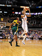 Sep 17 2011; Phoenix, AZ, USA; Phoenix Mercury guard DeWanna Bonner (24) puts up a shot against Seattle Storm forward Camille Little (20)during the first half at the US Airways Center.  Mandatory Credit: Jennifer Stewart-US PRESSWIRE..