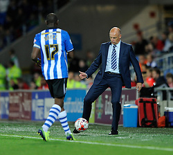 Wigan Athletic Manager, Uwe Rosler passes the ball back to Wigan Athletic's Emmerson Boyce - Photo mandatory by-line: Dougie Allward/JMP - Mobile: 07966 386802 19/08/2014 - SPORT - FOOTBALL - Cardiff - Cardiff City Stadium - Cardiff City v Wigan Athletic - Sky Bet Championship