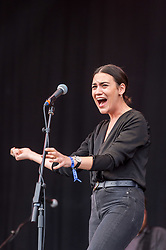 © Licensed to London News Pictures. 01/09/2018. Bristol, UK. The Downs Festival on The Downs in Bristol. Picture of NADINE SHAH on the main stage. The one day festival is taking place for the third year and features headliners Noel Gallagher's High Flying Birds, Paul Weller, and Orbital. Photo credit: Simon Chapman/LNP