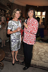 Left to right, CORTY HOWARD and LUCY VAUGHAN at a lunch in aid of the charity Kids Company held at Mark's Club, 46 Charles Street, London on 3rd October 2011.