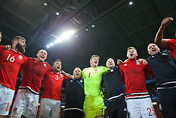 LILLE, FRANCE - Friday, July 1, 2016: Wales players celebrate in the team huddle following a 3-1 victory over Belgium and reaching the Semi-Final during the UEFA Euro 2016 Championship Quarter-Final match at the Stade Pierre Mauroy. Hal Robson-Kanu, David Cotterill, Neil Taylor, Kevin McCusker, goalkeeper Wayne Hennessey, Medical Officer Doctor Jon Houghton, Simon Church, performance psychologist Ian Mitchall. (Pic by David Rawcliffe/Propaganda)