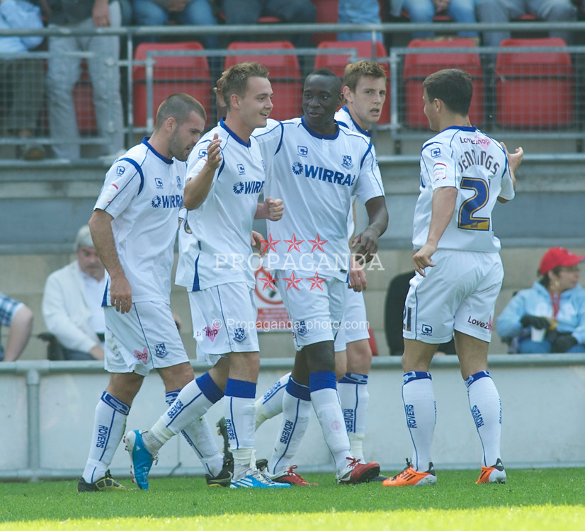 LONDON, ENGLAND - Saturday, April 30, 2011: Tranmere Rovers' Adam McGurk (2nd Left) celebrates after his goal makes it 2-0 against Leyton Orient during the Football League One match at Brisbane Road. (Photo by Gareth Davies/Propaganda)