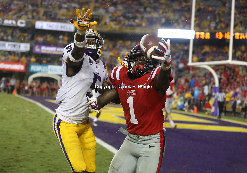 Sep 29, 2018; Baton Rouge, LA, USA; Mississippi Rebels wide receiver A.J. Brown (1) is defended by LSU Tigers cornerback Kary Vincent Jr. (5) during the second half of a game at Tiger Stadium. Mandatory Credit: Derick E. Hingle-USA TODAY Sports