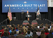 Vice President Joe Biden speaks at Iowa State University as Secretary of Agriculture Tom Vilsack listens in Ames, Iowa on Thursday, March 1, 2012.