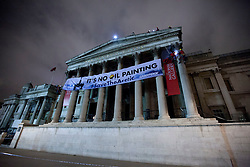 © Licensed to London News Pictures. 21/02/2012. LONDON, UK. A banner is seen hanging across the front of the National Gallery as part of a Greenpeace protest in London this evening (21/02/12).  The protest was held to correspond with a Shell Petroleum event being held at the gallery this evening. Photo credit: Matt Cetti-Roberts/LNP