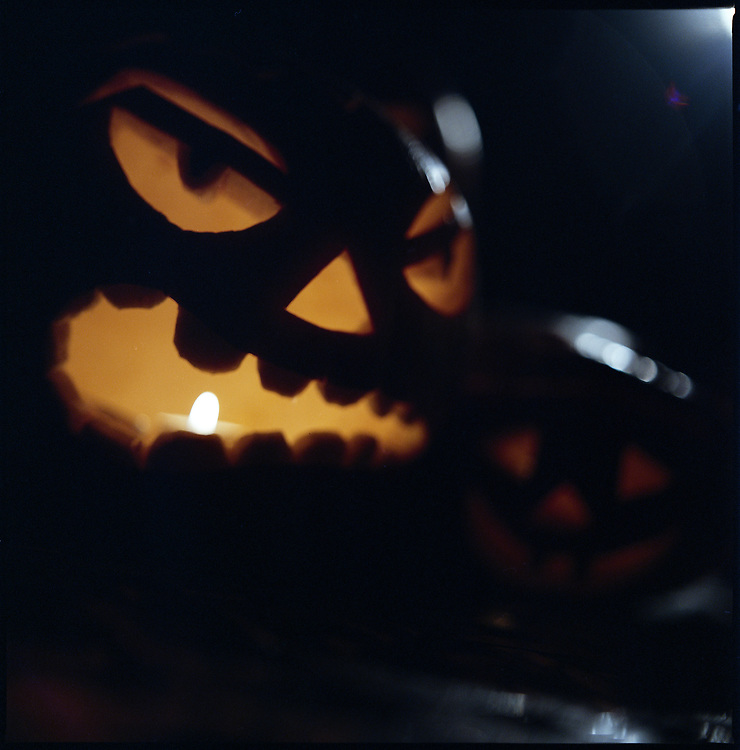Glowing hand carved Halloween pumpkins