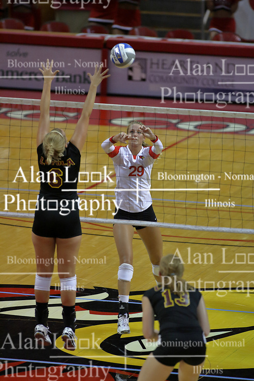31 Aug 2010: Mallory Leggett soft hands the ball over the net near Mallory Curran and Natalie Fiore. The Illinois State Redbirds trumped the Rambles of Loyola-Chicago 3 sets to none at Redbird Arena on the campus of Illinois State University in Normal Illinois.
