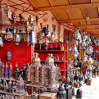 Metal Lanterns Displayed at Souk Haddadine in Marrakech, Morocco <br /> On display in numerous stalls of Marrakech&rsquo;s souks are ornate lanterns and scones. Their material ranges from bronze, brass, silver and sometimes tin. Historically, souqs served caravans of travelers.  The open-air markets of Marrakech date back to the early 12th century when it was walled-in to protect the early northwestern Africa settlers. Today, this remnant of medieval times is a maze of narrow streets, ancient buildings and traditional trades. The word &ldquo;souk&rdquo; was a French spelling from the 19th century.