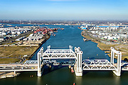 Nederland, Zuid-Holland, Rotterdam, 18-02-2015; bouw van de nieuwe Botlekbrug.<br /> De brug over de Oude Maas is een hefbrug, een van de twee brugdelen in geheven toestand. De heftorens van de oude brug gaan verscholen achter de nieuwe brug.<br /> Construction of the new Botlek bridge.<br /> The bridge over the Oude Maas is a vertical-lift bridge or lift bridge, one of the two bridge sections raised. <br /> luchtfoto (toeslag op standard tarieven);<br /> aerial photo (additional fee required);<br /> copyright foto/photo Siebe Swart