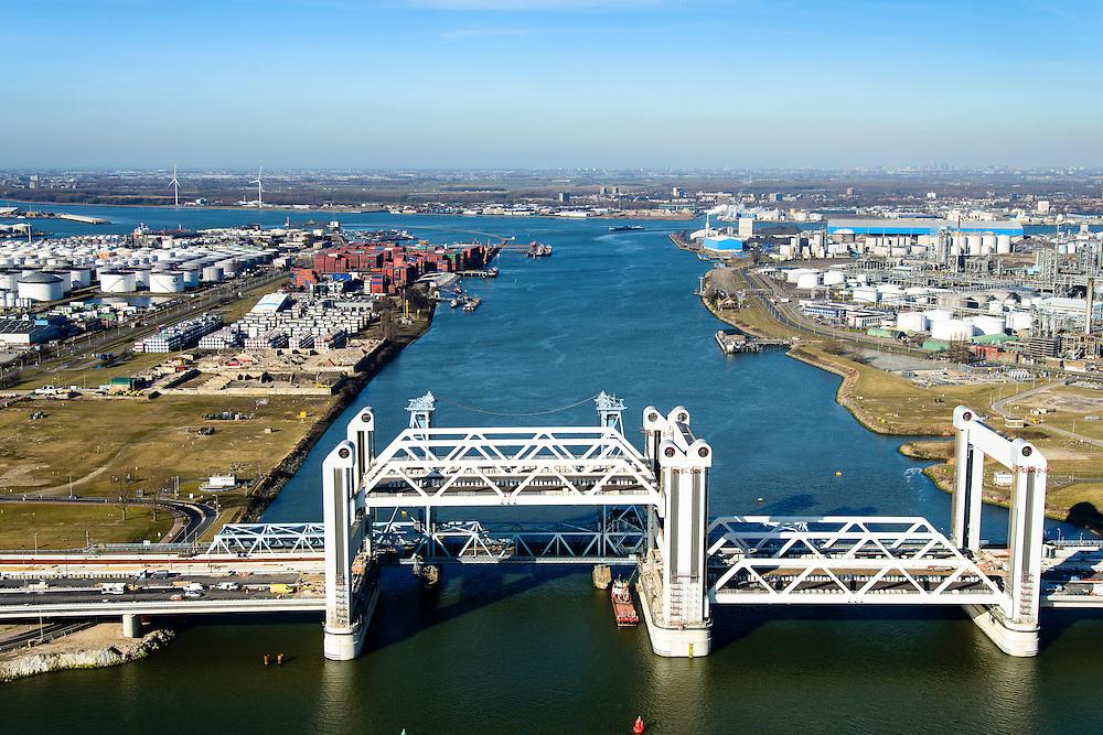 Nederland, Zuid-Holland, Rotterdam, 18-02-2015; bouw van de nieuwe Botlekbrug.<br /> De brug over de Oude Maas is een hefbrug, een van de twee brugdelen in geheven toestand. De heftorens van de oude brug gaan verscholen achter de nieuwe brug.<br /> Construction of the new Botlek bridge.<br /> The bridge over the Oude Maas is a vertical-lift bridge or lift bridge, one of the two bridge sections raised. <br /> luchtfoto (toeslag op standard tarieven);<br /> aerial photo (additional fee required);<br /> copyright foto/photo Siebe Swart