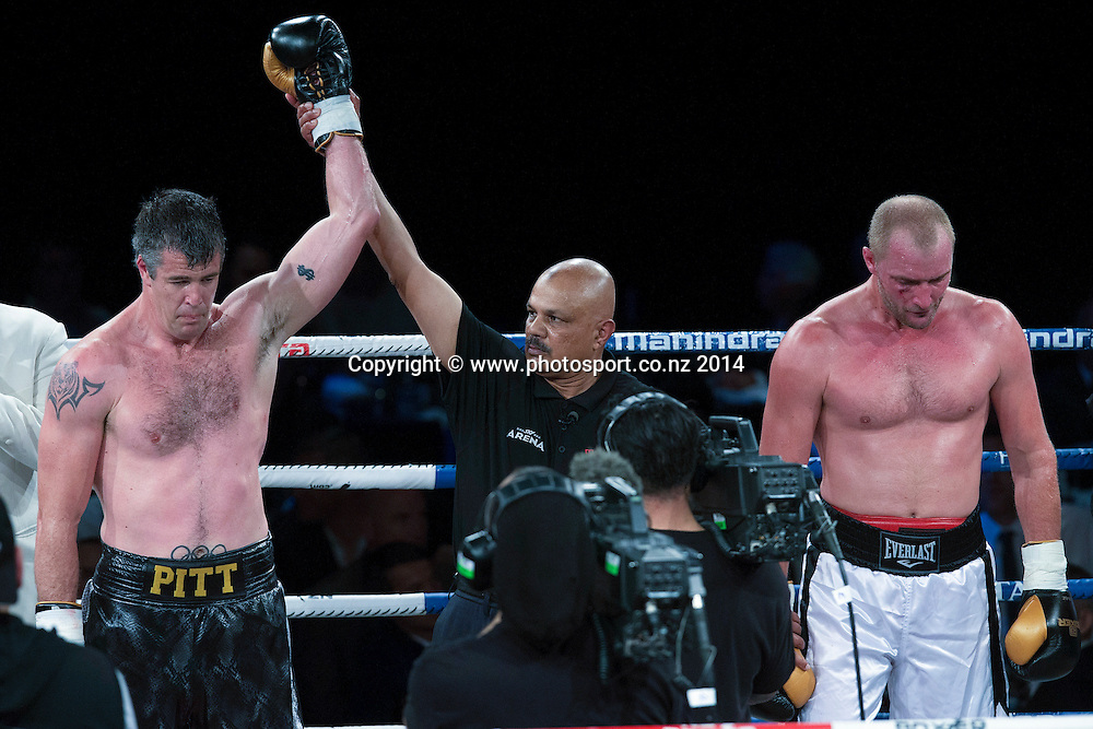 Brad `Hollywood` Pitt (L) wins his fight against Daniel Ammann in the Mahindra Super 8 Fight Night, North Shore Events Centre, Auckland, New Zealand, Saturday, November 22, 2014. Photo: David Rowland/Photosport