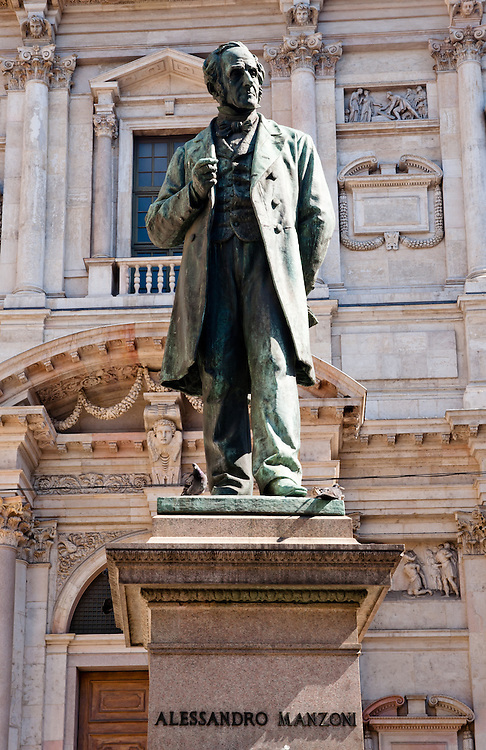 Alessandro Manzoni bronze statue in Piazza San Fedele in Milan.  Manzoni (1785-1873) was an italian poet and novelist, famous for the novel The Betrothed, ranked among the masterpieces of world literature.
